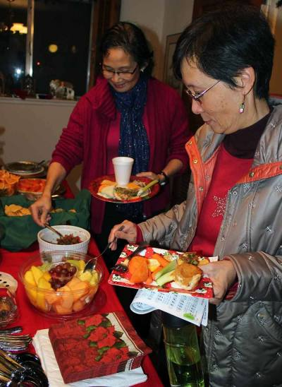 Members enjoyed a holiday potluck after caroling