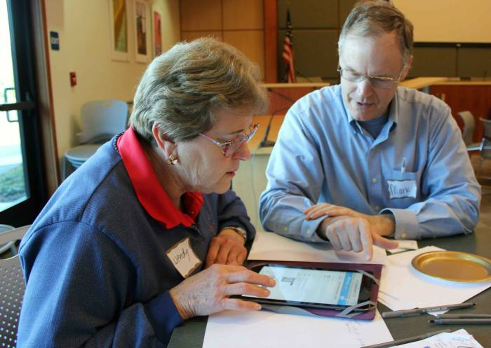 Wendy receiving tech help from TimeBank member, Mark
